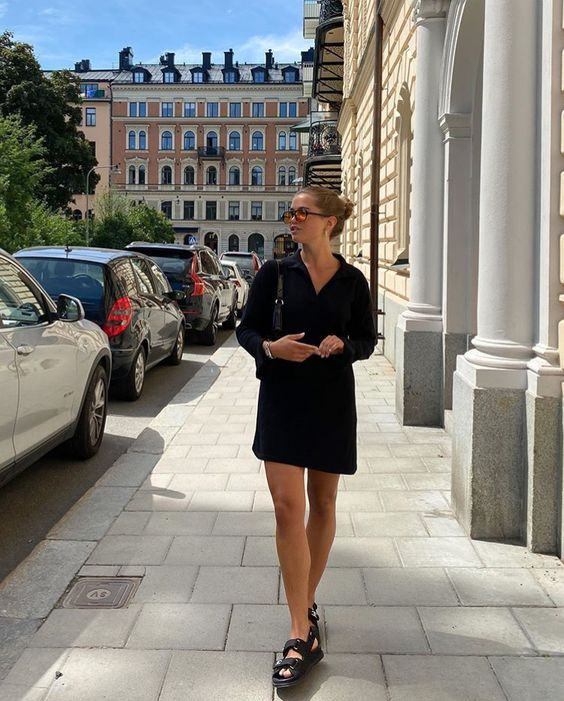 a black linen mini shirtdress, black dad sandals and a black bag for a simple and cool summer work look