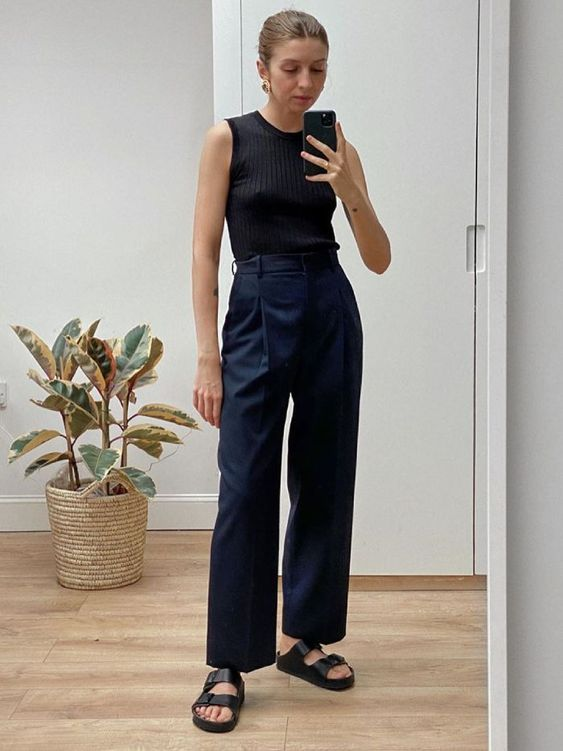 a black sleeveless top, navy trousers, black birkenstocks are great for a very laconic and bold summer work look
