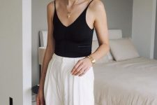 a black spaghetti strap top, white wideleg trousers – just grab a bag and you are ready to go