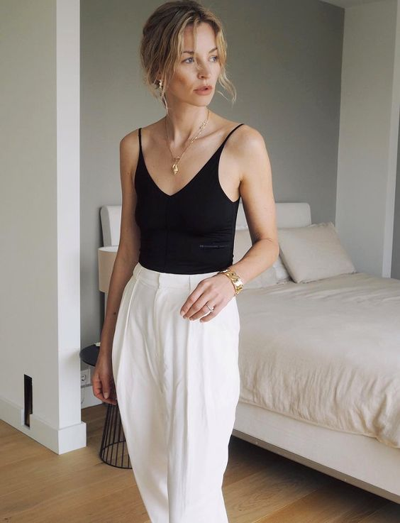 a black spaghetti strap top, white wideleg trousers - just grab a bag and you are ready to go