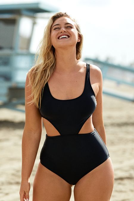 a black thick strap one piece swimsuit with side cutouts is a classic idea with a sexy twist