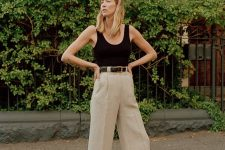 a black thick strap top, cropped linen pants, a black belt and black Oxford shoes for a hot summer day