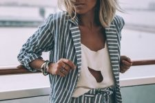 a blue and white striped short linen suit plus an eye-catchy white cutout top for a bold summer look
