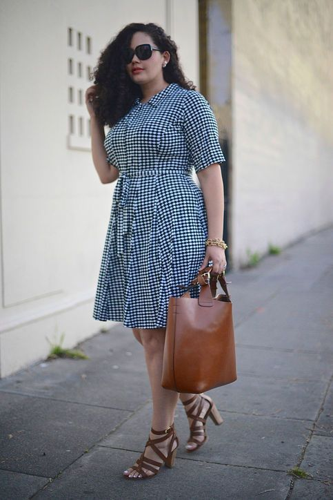 a blue gingham over the knee dress with a sash, brown strappy shoes and a brown tote for an easy and comfy look