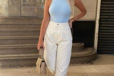 a blue halter neckling top, white high waisted jeans, white sneakers and an embellished nude bag