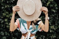 a breezy and light two piece summer dress with a tied crop top with short sleeves anda midi skirt, a hat