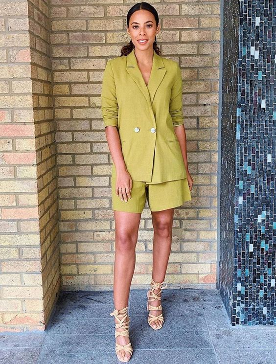 a bright green linen suit with an oversized blazer and shorts, lace up shoes for a trendy professional look