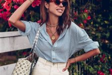 a casual summer look with a blue striped linen shirt, a neutral denim mini, a printed tote and layered necklaces