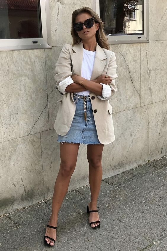 a chic and breezy look with a white tee, a tan blazer, a blue denim mini, black heels can be suitable for work