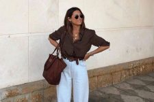 a chocolate brown shirt with cuffed sleeves, white linen pants, a brown belt and shoes, a brown tote for a hot summer day