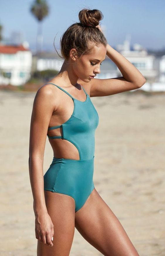 a cool blue one piece swimsuit with spaghetti straps and side cutouts plus an open back is wow