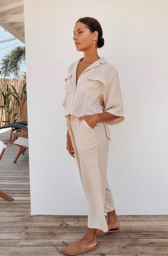 a cool neutral safari-style linen suti with pants, brown slippers for everyday will keep you fresh