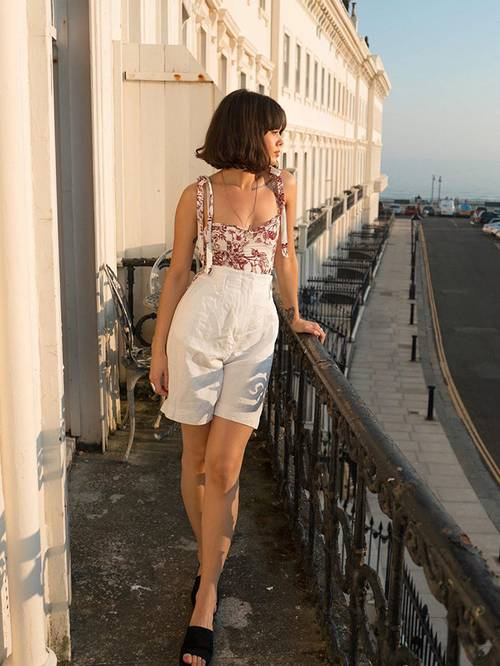 a floral top, white high waisted linen shorts, black heels for a very romantic look