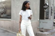a girlish look with a white tee, white jeans, black kitten heels and a straw beaded bag