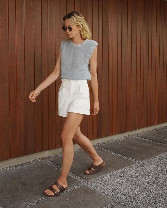 a grey accented shoulder top, white linen shorts and brown birkenstocks for a lovely casual look