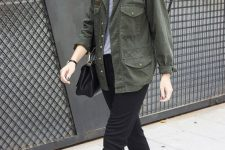 a grey top, black trousers, black birkenstocks, a black bag and a green army jacket for a stylish summer work look