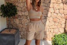 a hot day summer look with a tan bra top and tan shorts, trainers and a hat is perfect