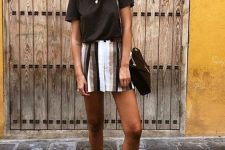 a lack t-shirt, a striped mini, grey birkenstocks and a black bag for a hot summer day