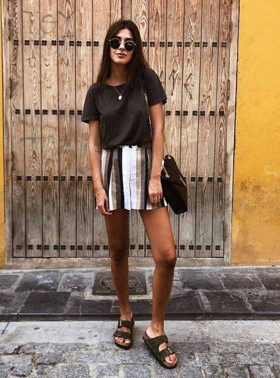 a lack t shirt, a striped mini, grey birkenstocks and a black bag for a hot summer day