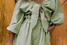 a lovely green linen suit of an off the shoulder crop blouse with puff sleeves and high waisted shorts for summer