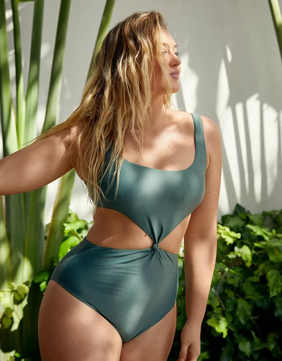 a lovely olive green one piece swimsuit with a square neckline and side cutouts is amazing