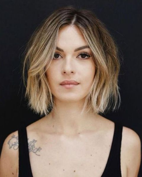 a lovely short bob with volume, texture and blonde balayage and face framing looks looks very fresh and modern