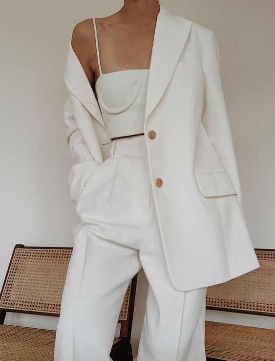 a luxurious work look with a white linen pantsuit with an oversized blazer and a neutral crop top with spaghetti straps