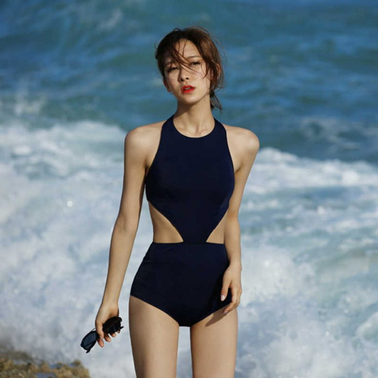 a minimalist navy halter neckline one piece with side cutouts is a trendy and chic idea