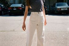 a navy and white t-shirt, white high waisted jeans and catchy black heels