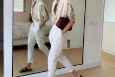 a neutral shirt, white trousers, black birkenstocks, a neutral jumper and a burgundy bag for a chic work look