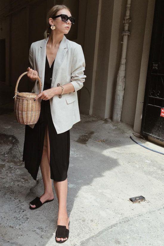 a pretty work look with a black linen wrap dress, black slipper mules, a neutral linen blazer and a basket as a bag