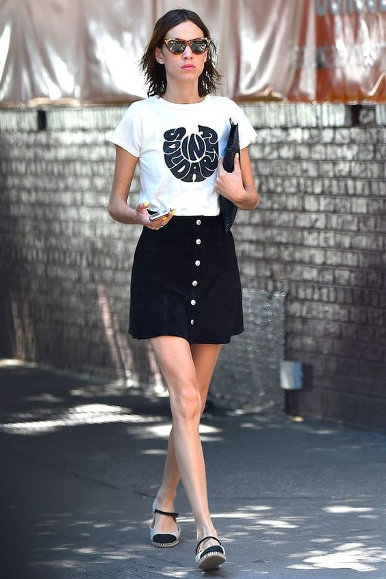 a printed t-shirt, a black button up A-line mini, two tone espadrilles and a black clutch for a contrasting look