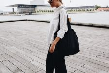a relaxed summer work look with a white shirt, black trousers, black birkenstocks, a black tote is a cool idea for a hot day