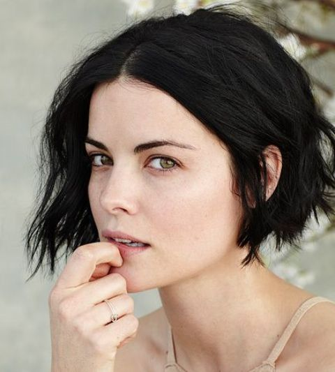 a short black bob with beachy waves looks very voluminous and bold