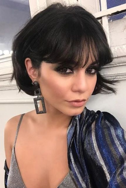 a short blunt black bob with bangs is a lovely idea that always looks stylish