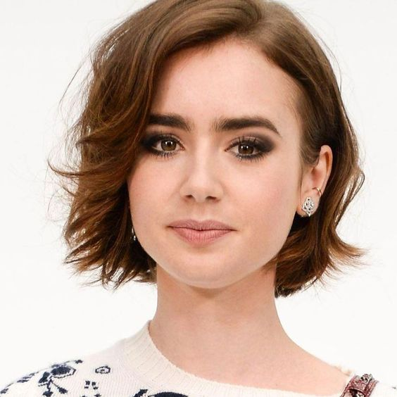 a short brunette bob with slight waves and side parting, with a touch of ladder is elegant and timeless