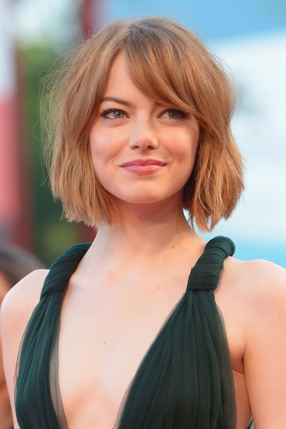 a short ginger textural bob with a curtain fringe is a stylish idea that feels like the 70s