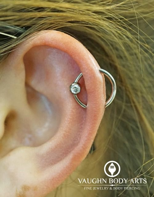a simple and cool helix orbital piercing with a hoop earring with a rhinestone is a lovely idea to rock