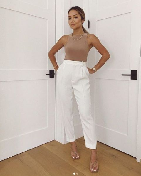 a simple and very trendy look with a nude halter neckline top, white high waisted trousers, nude heeled flipflops and a statement necklace