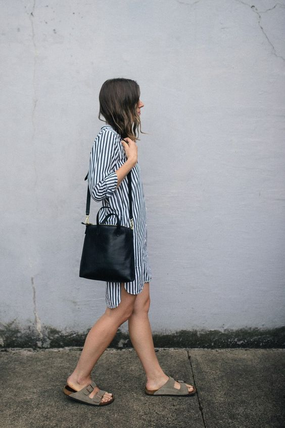 a striped black and white shirtdress, a black bag and grey birkenstocks compose a simple and cool summer outfit