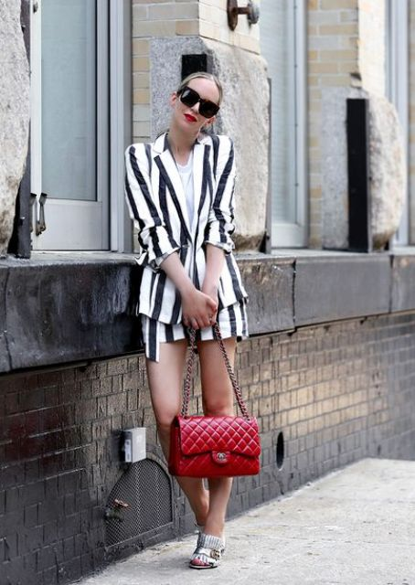 a striped linen suit with a white t-shirt, a red bag and silver shoes plus a red lipstick for summer