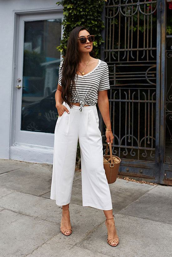 a striped t-shirt tied up, white culottes, elegant nude heels, a bucket bag and sunglasses for a hot day