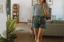 a striped tee, blue denim shorts with fringe and grey birkenstocks for a lovely summer look
