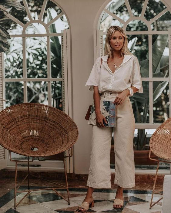 a stylish and relaxed work look with a white linen shirt, neutral linen pants, heels and a bag for a hot summer day