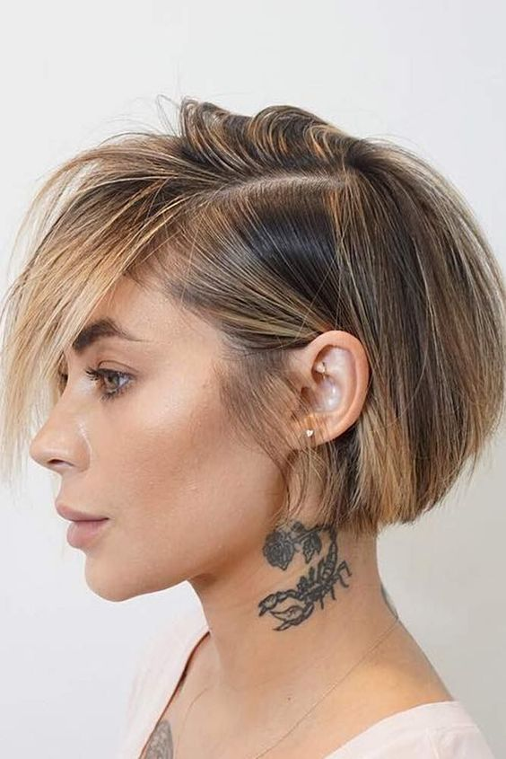 a stylish straight short bob with blonde balayage including face framing highlights looks bold and stylish
