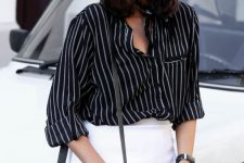 a stylish work-appopriate look with a black striped shirt, a white mini, a black bag and some bracelets