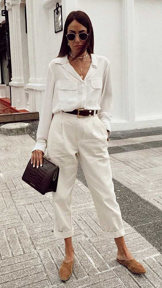 a stylish work outfit with a white shirt and pants, a black belt, a chocolate brown bag and nude slipper mules