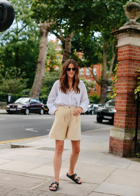a summer outfit with a striped shirt, tan linen shorts, black Birkenstocks for a realxed feel