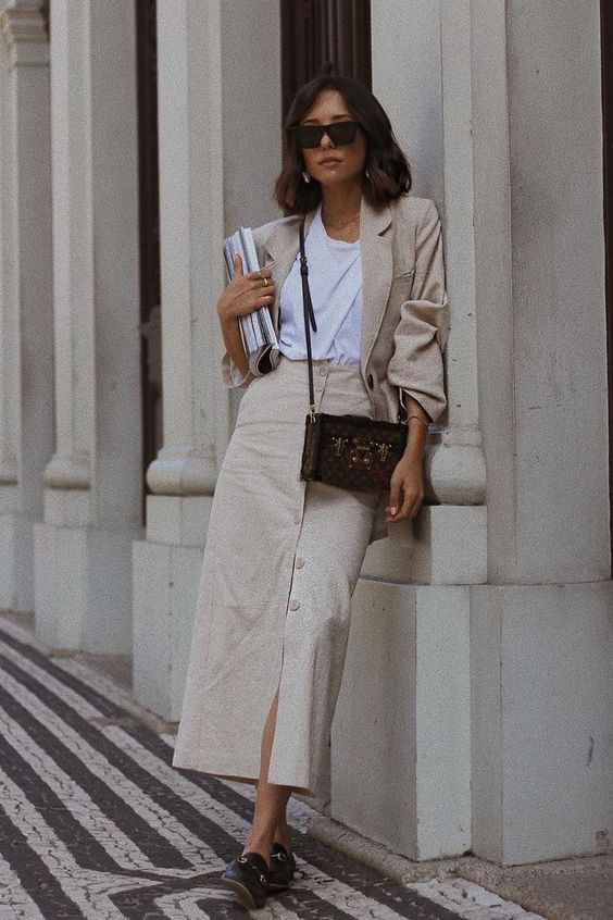 a summer work look with a white tee, a neutral linen blazer and a midi button up skirt, a black bag and slipper mules
