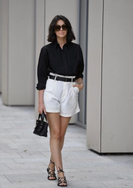 a super chic work look with a black linen shirt and white shorts, a black belt, lace up sandals and a bag